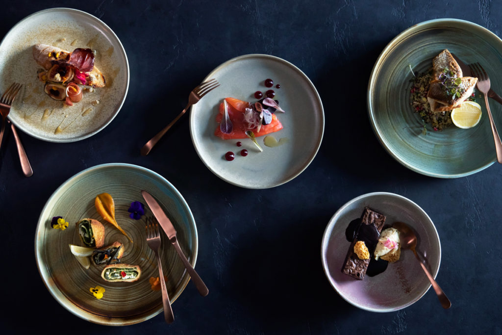 Images of Food on Plates with Copper Forks and Knives